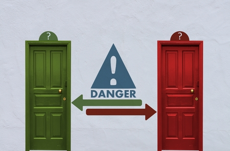 where is the Danger behind the red or the green door? A concept image showing two nostalgia doors with a Danger icon painted on the wall in between Stock Photo - 29284061