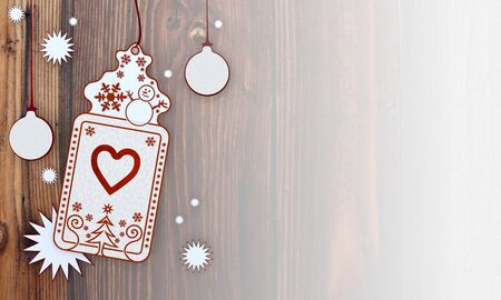 loving: loving illustration of a christmas card with heart label in front of a wooden background with gradient to white Stock Photo