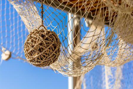 fish net: Brown wicker ball and fish net. Stock Photo