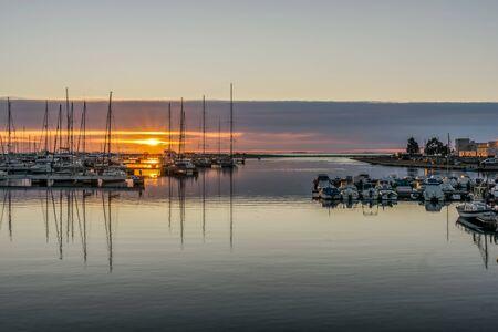 spanish village: Dramatic and beautiful dawn in marina over to spanish village of Sant Carles de la Rapita in Spain
