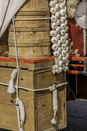 horse cart: Sale of fresh garlic hanging from a horse cart