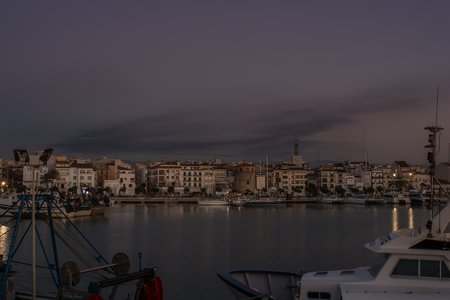 Spectacular view of the port of Tarragona. Spain. Few minutes before dusk on an October day. One can enjoy the view of a sky full of clouds covering the whole port. Stock Photo