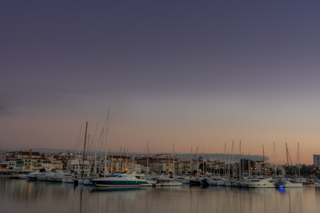 Spectacular view of the port of Tarragona. Shortly after sunset on an October day. One can enjoy the view of a sky full of clouds covering the whole port. Stock Photo