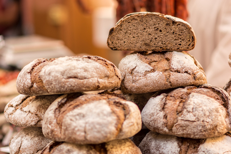 Natural Fresh baked bread cut into slices ready to taste natural food market During. Natural Fresh baked bread is a must During a typical medieval and craft fairs, and They are made in many forms and tastes. The so-called round bread is The most common ty