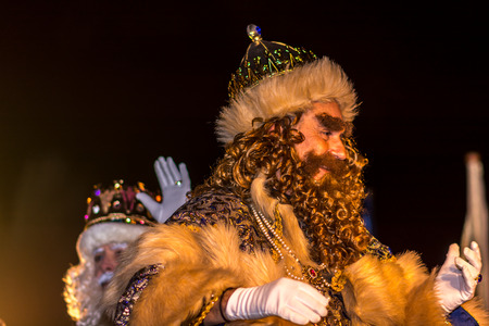 The three wisemen, here Gaspar, at the Three Wisemen parade, bringing candy and happy wishes to all the children that comes to see them within the citys main streets of Tarragona, Spain. Arrival and parade is made on the 5th of january. Editorial