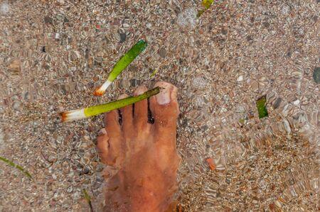 Feet in the seaside of mediterranean water