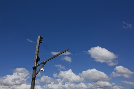 Electricity post in the blue sky photo