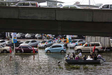 tollway: BANGKOK-NOV 5:Flood hits Bangkok areas around Tollway, higher water levels than expected,transportation affected by flood on November 5, 2011 on vibhavadee Rd,Thailand (Donmuang Area)