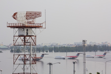 tollway: BANGKOK-NOV 5:Flood hits Bangkok areas around Tollway, higher water levels than expected,aircraft affected by flood on November 5, 2011 on vibhavadee Rd,Thailand ( Donmuang Airport)
