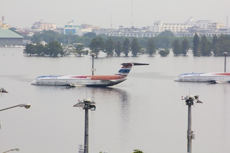 affected: BANGKOK-NOV 5:Flood hits Bangkok areas around Tollway, higher water levels than expected,aircraft affected by flood on November 5, 2011 on vibhavadee Rd,Thailand ( Donmuang Airport)