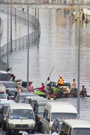 tollway: BANGKOK-NOV 5:Flood hits Bangkok areas around Tollway, higher water levels than expected,transportation affected by flood on November 5, 2011 on vibhavadee Rd,Thailand (Jatujak Area) Editorial