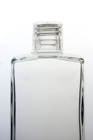 Clear Bottle on gradient background photo