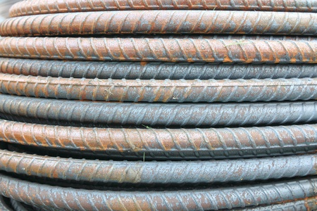 reinforcing bar: steel rods in construction background texture