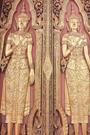 Carved angel on the temple door at wat yai chaimongkol temple, ayutthaya photo