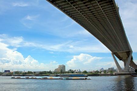 bhumibol: sand ships carrying pass Bhumibol Bridge, thailand Stock Photo