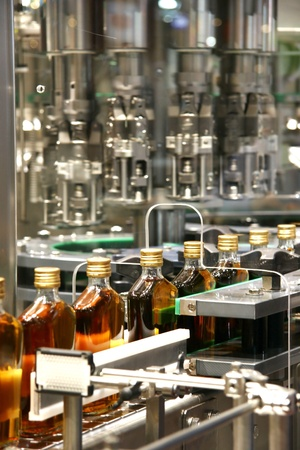 filling line: liquid filling machines in Whiskey industry plant