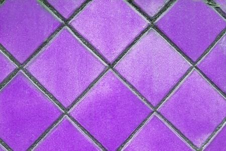 bathroom tile: purple mosaic tiles floor Stock Photo