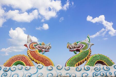 Chinese dragon statue on blue sky background photo