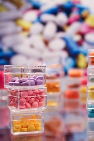 Multi-colored pills in a plastic boxs Stock Photo - 14190158