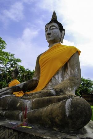 Buddha Status and the pagoda at wat yai chaimongkol temple, Ayutthaya, Thailand photo