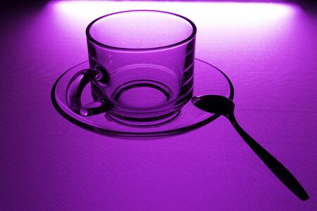 cup of coffee on the violet color background