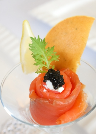 catering food: Smoked salmon rolls with cream chees