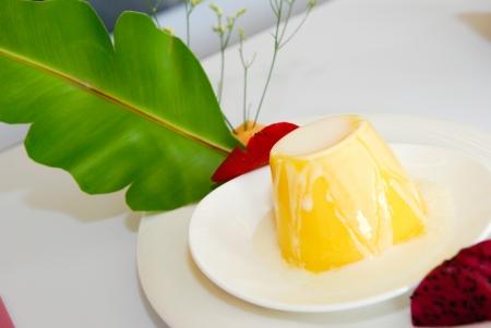 Mango Pudding with coconut milk sauce photo