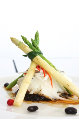 Fresh steam fish and vegetable with soy sauce Standard-Bild