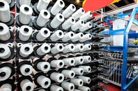Textile industry - Weaving and warping Stock Photo - 15550958