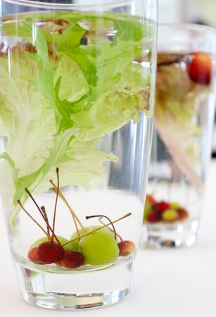 Many berry, grape and water in the glass for decorated photo