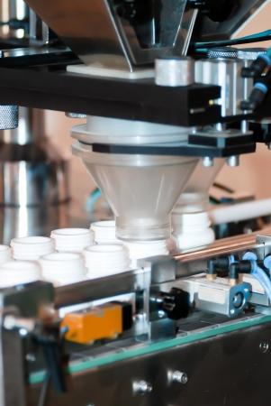 pharmaceutical plant: Pill filling machine in the plastic bottle