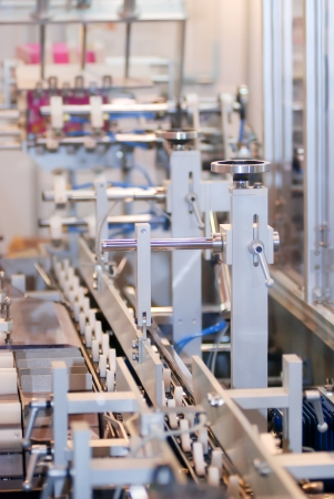 filling line: Product on the conveyor in factory