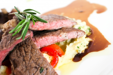 Sirloin beef steak with mashed potato and tomato