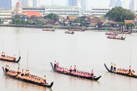 CHAO PHRAYA RIVER, BANGKOK, THAILAND – OCTOBER 19: The 6th Practice of Thai Royal Barge procession cruises down the Chao Phraya river to celebrate 85th King of Thailand on the throne (December 5, 2012) in Bangkok, Thailand on October 19, 2012