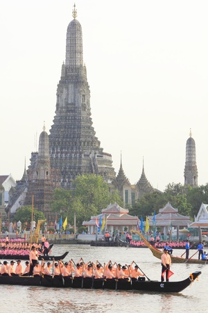 procession: BANGKOK, THAILAND, OCTOBER 19: 6th Practice of Thai Royal Barge procession cruises down the Chao Phraya river with Wat Arun in background to celebrate 85th King of Thailand on the throne.
