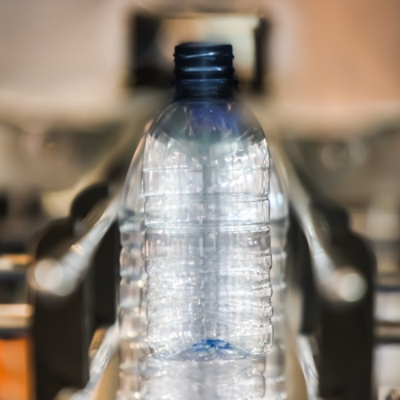 Bottling water on the conveyor in the factory