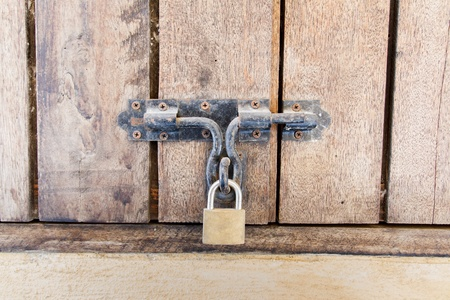 Wooden doors locked with padlock photo