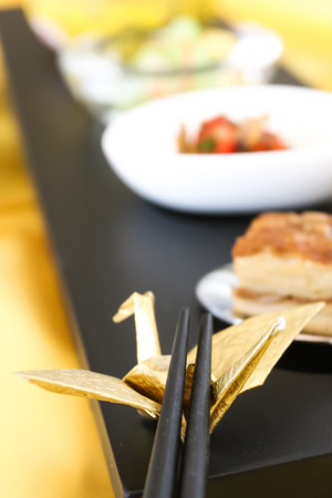 Chinese food set on the black plate and chopsticks  Stock Photo - 23040901