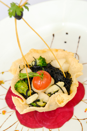 Spaghetti with squid ink in dumpling fried photo