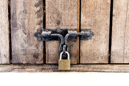 Wooden doors locked with padlock photo