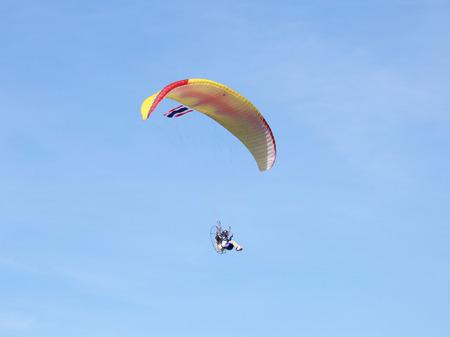 daring: Paramotor flying in the sky Stock Photo
