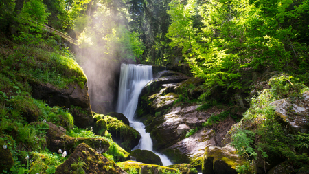 Black Forest - Triberg Waterfall with vapour and sunshine Stock Photo