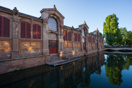 Reflecting ancient building of little venice in Colmar