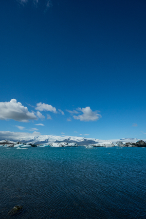 Iceland - Deep blue sky at glacial lake covered by icebergs Stock Photo