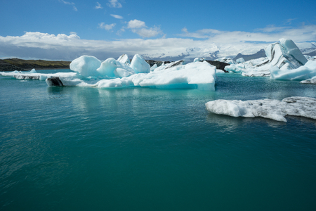 Iceland - Clear blue water of glacial lake covered by ice