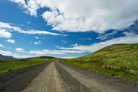curve road: Iceland - Lonely path through green countryside of hills with nobody