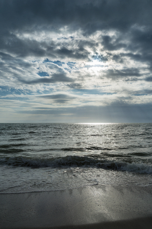 USA, Florida, Dramatic sky and cloud formations at a beach near tampa with reflections on water