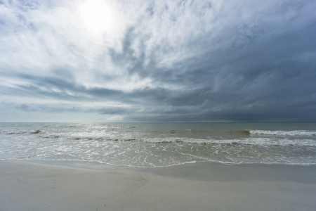 USA, Florida, Empty and untouched beach of tampa with sun and little waves Stock Photo