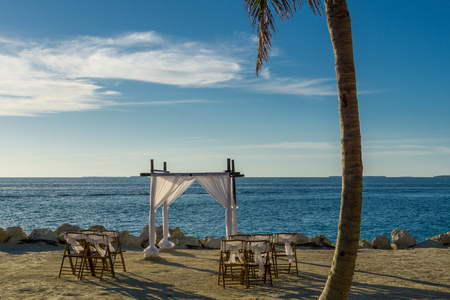 Romantic little wedding ceremony at the beach of key west at sunset, USA, Florida