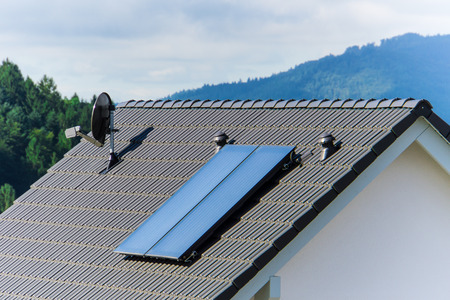 New build house roof with solar heating system for green energy supply